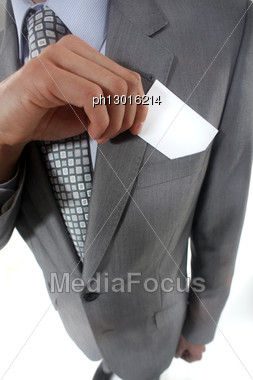 Businessman Pulling A Business Card Out Of His Pocket Stock Photo
