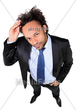 Businessman Putting His Sunglasses Stock Photo