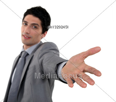 Businessman Reaching His Hand Out Stock Photo