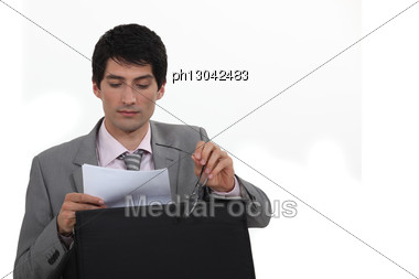 Businessman Reading His Notes Stock Photo