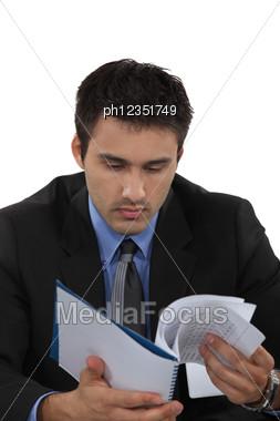 Businessman Reading Notes. Stock Photo