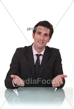 Businessman Sat At His Desk Stock Photo