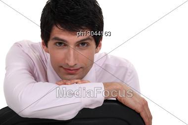 Businessman Sat On Chair Backwards Stock Photo