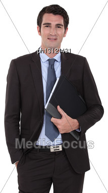 Businessman Standing With His Folder Stock Photo