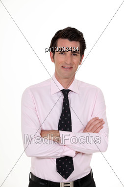 Businessman Stood With Arms Folded Stock Photo