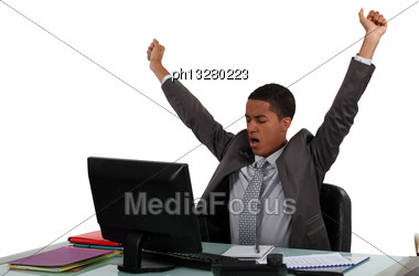 Businessman Stretching Stock Photo
