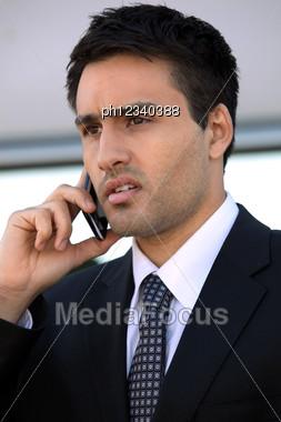 Businessman Using A Cellphone Stock Photo