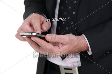 Businessman Using A Smartphone Stock Photo