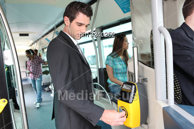 Businessman Validating Travel Card Stock Photo