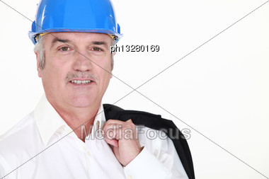 Businessman Wearing Helmet And Smiling Stock Photo