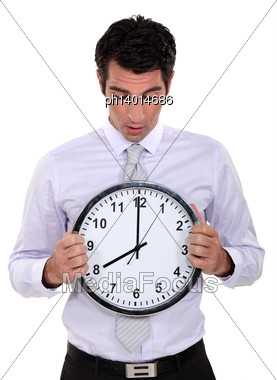 Businessman With A Clock Stock Photo
