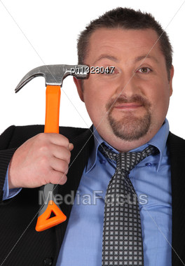 Businessman With A Hammer Stock Photo