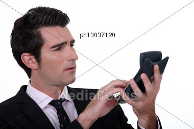 Businessman With Calculator Stock Photo