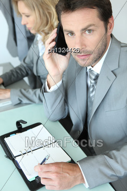 Businessman With Note Pad Stock Photo