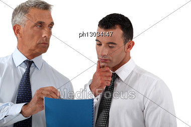 Businessmen Discussing A Document Stock Photo