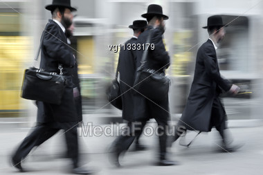 Businessmen Rushing On The Street In Intentional Motion Blur,side Rear View Stock Photo