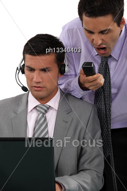 Businessmen Under A Lot Of Pressure Stock Photo