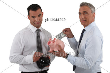 Businessmen With Piggy Banks Stock Photo
