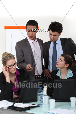 Businesspeople During Meeting Stock Photo