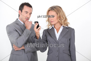 Businesspeople Expecting A Message On Phone Stock Photo