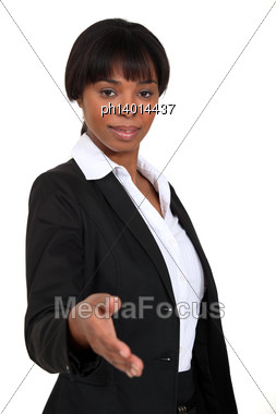 Businesswoman About To Shake Hands Stock Photo