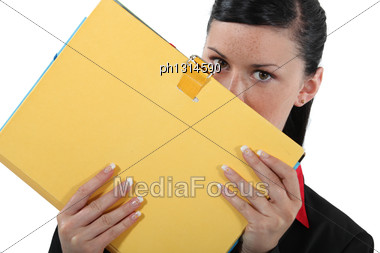 Businesswoman Covering Face With File Stock Photo