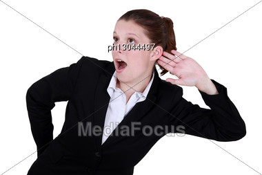 Businesswoman Exaggerating Listening Stock Photo