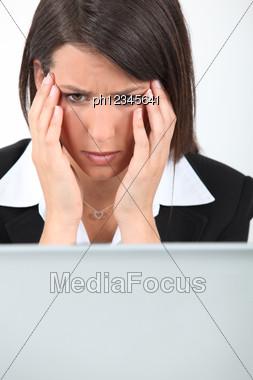 Businesswoman Having Computer Problems Stock Photo