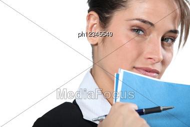 Businesswoman Holding Blue Folder Near Face Stock Photo