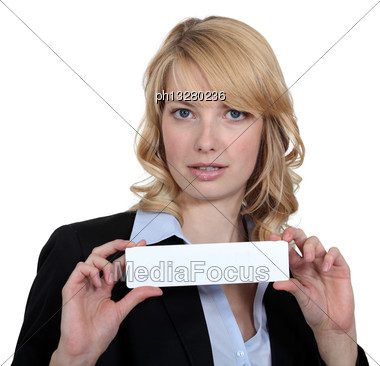 Businesswoman Holding Up A Blank Card Stock Photo