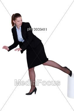 Businesswoman Kicking A Stool Stock Photo