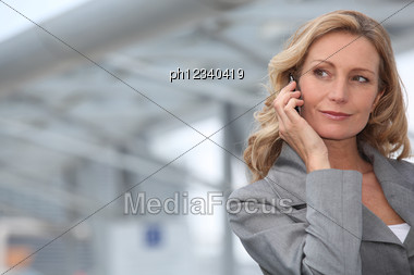 Businesswoman On Mobile Phone Stock Photo