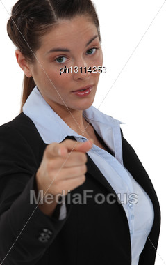 Businesswoman Pointing At The Camera Stock Photo