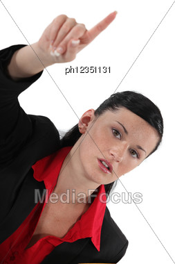 Businesswoman Raising Her Hand Stock Photo