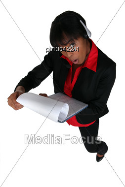 Businesswoman Shocked By Document Stock Photo
