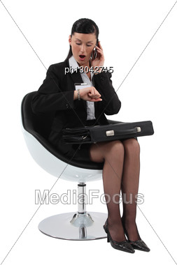 Businesswoman Shocked Looking At Her Watch Stock Photo