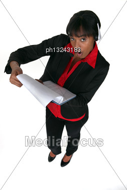 Businesswoman Shocked Whilst Reading Clip-board Stock Photo