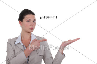 Businesswoman Showing The Way. Stock Photo