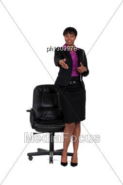 Businesswoman Stretching Hand For Handshake Stock Photo