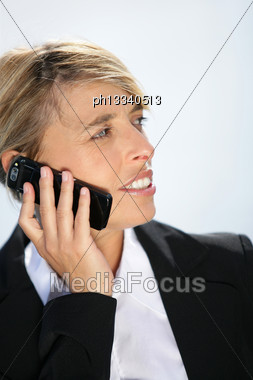 Businesswoman Talking On Her Mobile Phone Stock Photo