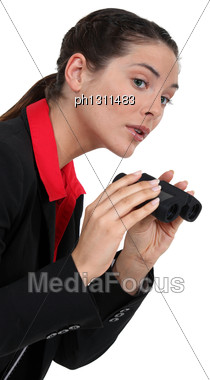 Businesswoman With Binoculars Stock Photo