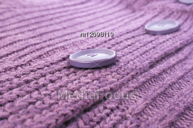 Buttons On Violet Sweater. Stock Photo