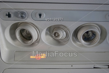 Cabin Inside The Aircraft, Lights, Air Condition And Signs Panel Above The Seat Stock Photo