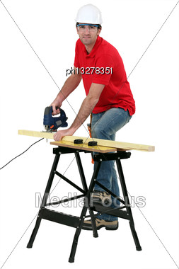 Cabinetmaker Cutting Wood Stock Photo
