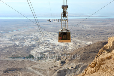 Cableway Cabin Descends From The Fortress Masada. Stock Photo