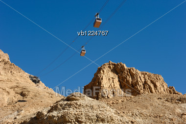 Cableway Cabins Descends From The Fortress Masada. Stock Photo