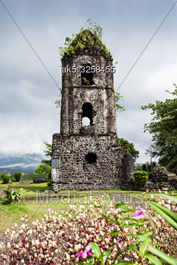 Cagsawa Ruins Are The Remnants Of An 18th Century Franciscan Church, Built In 1724 And Destroyed By The 1814 Eruption Of The Mayon Volcano Stock Photo