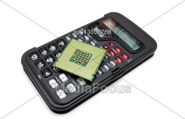 Calculator Of Black Color With The Computer Processor On It Stock Photo