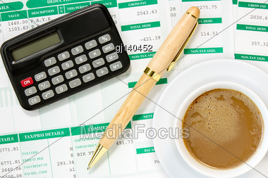 Calculator And Coffee Cup In An Environment Of Financial Calculations Stock Photo