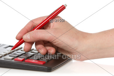 Calculator And Hand With Pen Stock Photo